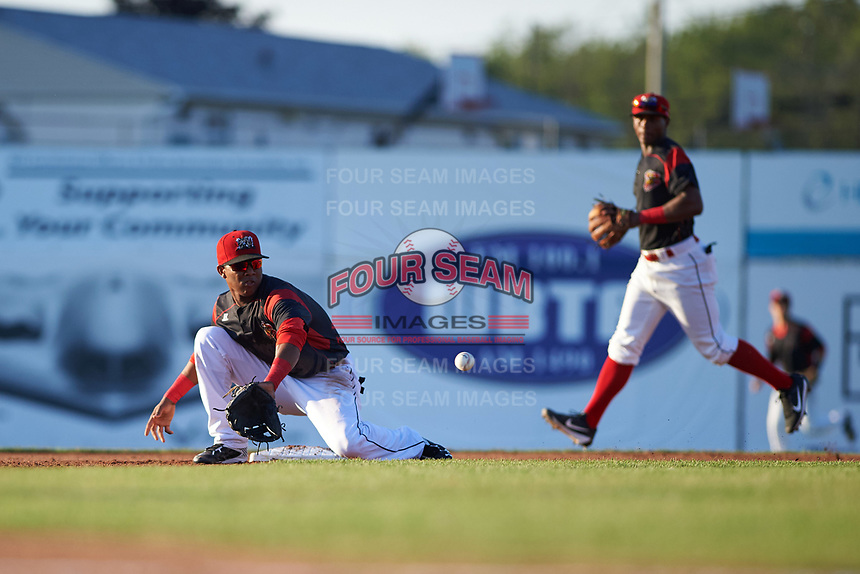 Batavia Muckdogs shortstop Marcos Rivera (8) stretches for a throw on a stolen base attempt as second baseman Samuel Castro (5) backs up the play during a game against the Lowell Spinners on July 11, 2017 at Dwyer Stadium in Batavia, New York.  Lowell defeated Batavia 5-2.  (Mike Janes/Four Seam Images)