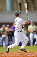 Sam Foy (2) of the Davidson Wildcats follows through on his swing against the Western Carolina Catamounts at Wilson Field on March 10, 2013 in Davidson, North Carolina.  The Catamounts defeated the Wildcats 5-2.  (Brian Westerholt/Four Seam Images)
