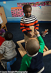 Education Preschool 3-4 year olds two boys working together building with blocks, one boy gesturing and making suggestion