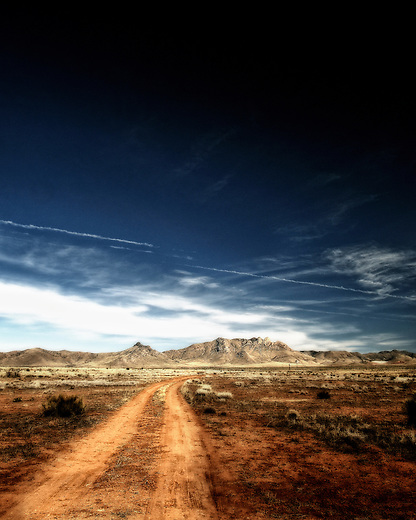 Desolate dirt road leading in to the desert of Arizona