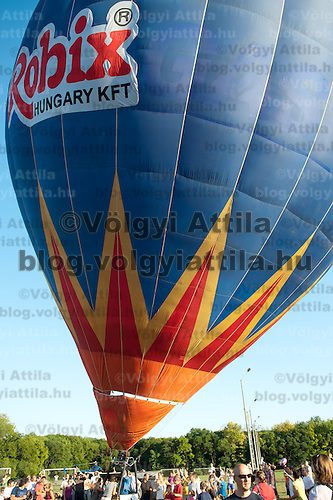 Participants prepare for takeoff during the Velence Lake International Hot Air Balloon Festival in Agard, Slovakia on September 10, 2011. ATTILA VOLGYI