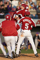 The South Carolina Gamecocks celebrate at home plate following their 7-6 win over the East Carolina Pirates in 11 innings at Sarge Frye Field in Columbia, SC, Sunday, February 24, 2008.