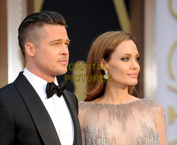 HOLLYWOOD, CA - MARCH 2: Brad Pitt, Angelina Jolie arriving to the 2014 Oscars at the Hollywood and Highland Center in Hollywood, California. March 2, 2014. <br /> CAP/MPI/COR<br /> &copy;Corredor99/ MediaPunch/Capital Pictures