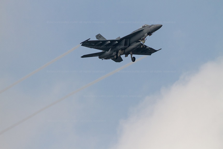 A McDonnell Douglas F/A-18 Hornet with the American Navy in flies low over Chou Rinkan in Kanagawa, Japan. Tuesday May 31st 2016. People in this area live under the flight path of Camp Zama and have to get used to fighter jets and other aircraft of the US Navy and JSDF buzzing their apartment buildings.