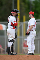 Illinois State Redbirds catcher Paul DeJong (14) talks with pitcher Mitch Vogrin (20) during a game against the Bucknell Bison on March 8, 2015 at North Charlotte Regional Park in Port Charlotte, Florida.  Bucknell defeated Illinois State 13-8.  (Mike Janes Photography)