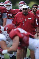 NWA Democrat-Gazette/ANDY SHUPE<br /> Arkansas coach Bret Bielema directs his players Tuesday, Aug. 11, 2015, during practice at the university's practice field in Fayetteville.
