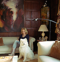 Portrait of writer Ros Byam Shaw and her dog Tasha in her wood-panelled living room
