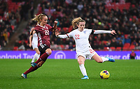 9th November 2019; Wembley Stadium, London, England; International Womens Football Friendly, England women versus Germany women; Lauren Hemp of England plays the ball forward under pressure from Turid Knaak of Germany - Editorial Use