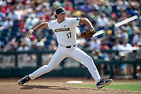 Michigan Wolverines pitcher Jeff Criswell (17) delivers a pitch to the plate against the Texas Tech Red Raiders during the first game of the NCAA College World Series on June 15, 2019 at TD Ameritrade Park in Omaha, Nebraska. Michigan defeated Texas Tech 5-3. (Andrew Woolley/Four Seam Images)