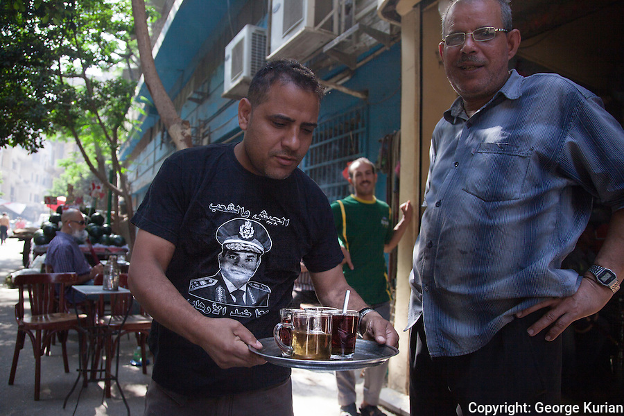 A waiter in a road side cafe with a Sisi tee shirt. He did not want to be identified by name.