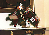 """Washington, DC - December 4, 2000 -- The pier table on the landing of the Grand Staircase in the White House in Washington, D.C. on December 4, 2000 showcases a vignette of ornaments made by architects and architectural students in 1995 for the White House """"Twas the Night Before Christmas"""" theme..Credit: Ron Sachs - CNP"""