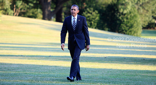 United Ststes President Barack Obama returns to the White House on August 29, 2012..Credit: Dennis Brack / Pool via CNP