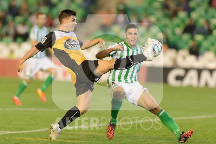 Sevilla, España, 15 de octubre de 2014: Julio Fernandez (I) controla el balon ante Bruno (D) partido entre Real Betis y Lugo correspondiente a la jornada 5 de la Copa del Rey 2014-2015 celebrado en el estadio Benito Villamarain de Sevilla.