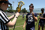 CHAPEL HILL, NC - MAY 20: Navy's Julia Collins (22) has her stick checked. The University of North Carolina Tar Heels hosted the U.S. Naval Academy Midshipmen on May 20, 2017, at Fetzer Field in Chapel Hill, NC in an NCAA Women's Lacrosse Tournament Quarterfinal match. Navy won the game 16-14.