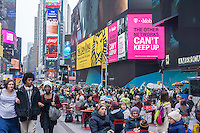 Throngs of tourists in Times Square in New York on Friday, April 10, 2015. A strong dollar is making it less attractive to visit New York (and spend money!) possibly cutting into the tourism business. The tourism industry generates $60 billion dollars going into the New York economy. 55 million people visited the city last year with tourism jobs jumping 22% in the last decade.  (© Richard B. Levine)