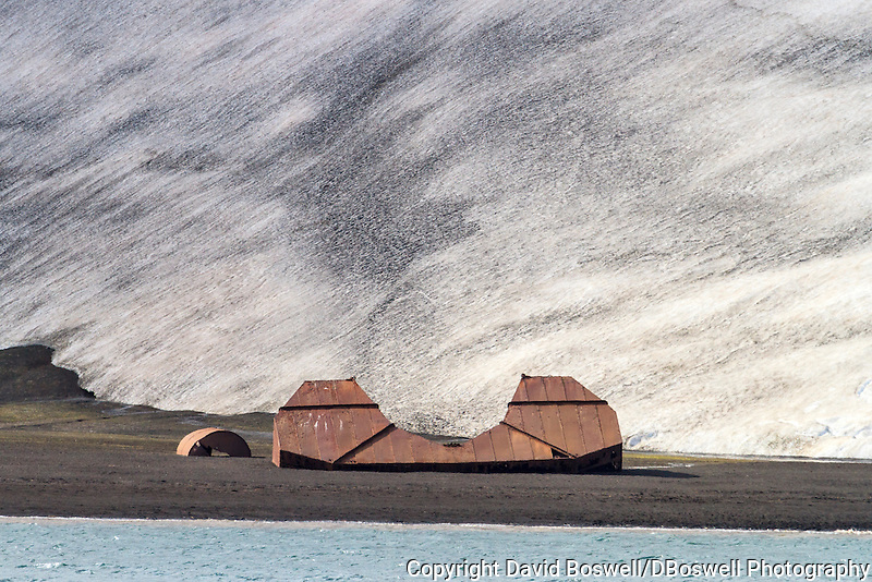 A rusted floating dock is one of the remnants of the bygone whaling era left at an abandoned Norwegian whaling base in Whalers Bay on Deception Island, in the South Shetland Islands near the Antarctic Peninsula.