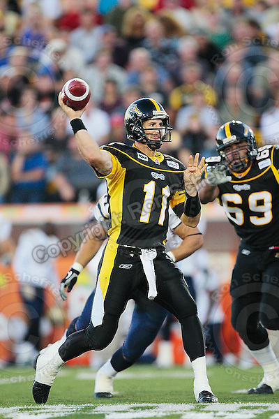 Aug 3, 2007; Hamilton, ON, CAN; Hamilton Tiger-Cats quarterback (11) Jason Maas throws a pass against the Winnipeg Blue Bombers during the first half at Ivor Wynne Stadium. Mandatory Credit: Ron Scheffler