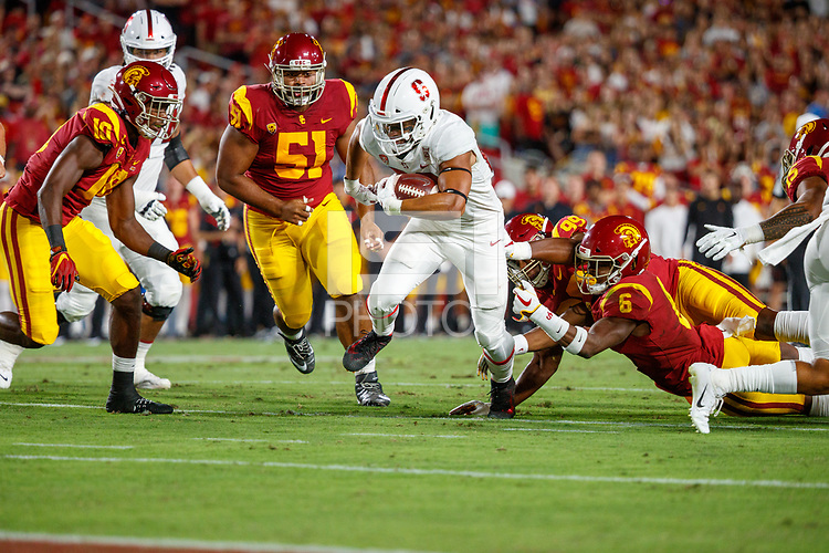 LOS ANGELES, CA - SEPTEMBER 7: Stanford Cardinal running back Cameron Scarlett #22 runs toward the end zone during a game between USC and Stanford Football at Los Angeles Memorial Coliseum on September 7, 2019 in Los Angeles, California.