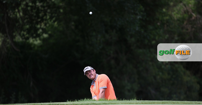 Atti Schwartzel (RSA) finds the edge of the 17th green during Round One of 2014 Alfred Dunhill Championship at the Leopard Creek Country Club, Malelane, Mpumalanga, South Africa. Picture:  David Lloyd / www.golffile.ie