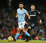 Sergio Aguero of Manchester City with Aaron Cresswell of West Ham United during the premier league match at the Etihad Stadium, Manchester. Picture date 3rd December 2017. Picture credit should read: Andrew Yates/Sportimage