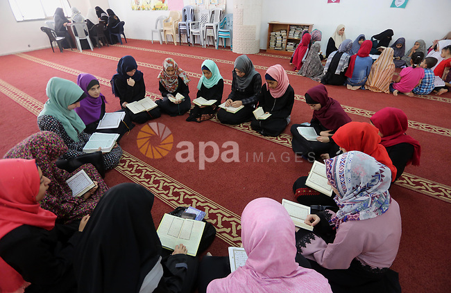 Palestinian girls attend a lesson of Koran, Islam's holiest book on the Muslim holy fasting month of Ramadan, at Dar Al Ketab and Sunna in Gaza city, on June 12, 2017. Ramadan is sacred to Muslims because it is during that month that tradition says the Koran was revealed to the Prophet Mohammed. The fast is one of the five main religious obligations under Islam. More than 1.5 billion Muslims around the world will mark the month, during which believers abstain from eating, drinking, smoking and having sex from dawn until sunset. Photo by Mohammed Asad