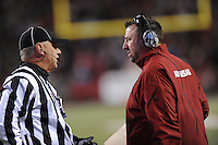 NWA Media/ANDY SHUPE - Arkansas coach Bret Bielema confers with a game official against LSU during the second quarter Saturday, Nov. 15, 2014, at Razorback Stadium in Fayetteville.