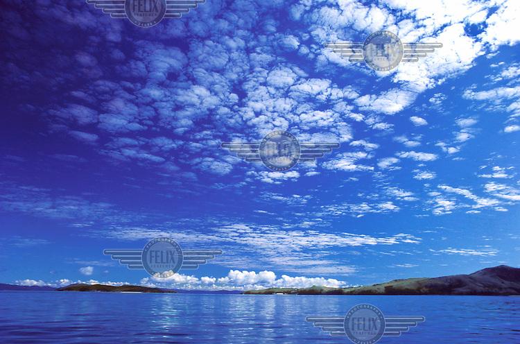 Cumulus clouds in the sky over the coast.
