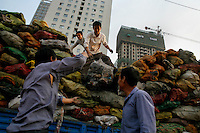 Workers load up a truck in Nanjing, China.