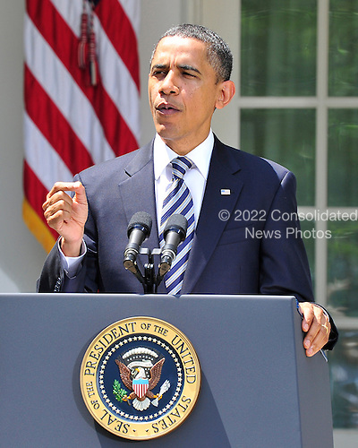 United States President Barack Obama makes a statement in the Rose Garden of the White House in Washington, D.C. following U.S. Senate passage by a margin of 74 - 26 of the bill that averted a U.S. default on its financial obligations this evening by increasing the government's borrowing authority..Credit: Ron Sachs / CNP