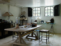 Jill works off a scrubbed wooden table in a delightfully unpretentious room