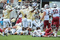 September 28, 2013 - Orlando, FL, U.S: South Carolina Gamecocks quarterback Connor Shaw (14) lays in pain after being hit and fumbling the ball during 1st half NCAA football game action between the South Carolina Gamecocks and the UCF Knights at Bright House Networks Stadium in Orlando, Fl