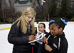 Gracie Gold signs for skaters at Skating with the Stars - a benefit gala for Figure Skating in Harlem in its 17th year is celebrated with many US, World and Olympic Skaters honoring Michelle Kwan and Jeff Treedy on April 7, 2014 at Trump Rink, Central Park, New York City, New York. (Photo by Sue Coflin/Max Photos)