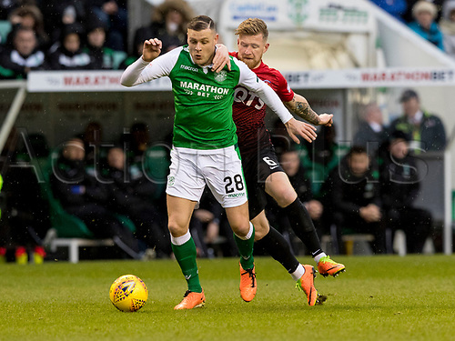 30th December 2017, Easter Road, Edinburgh, Scotland; Scottish Premier League football, Hibernian versus Kilmarnock; Alan Power of Kilmarnock holds back Anthony Stokes of Hibernian