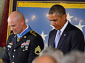 United States President Barack Obama bows his head in prayer after awarding the Medal of Honor for conspicuous gallantry to Staff Sergeant Ty M. Carter, U.S. Army, during a ceremony in the East Room of the White House in Washington, D.C. on Monday, August 26, 2013.  Staff Sergeant Carter is being honored for courageous actions while serving as a cavalry scout with Bravo Troop, 3rd Squadron, 61st Cavalry Regiment, 4th Brigade Combat Team, 4th Infantry Division, during combat operations in Kamdesh District, Nuristan Province, Afghanistan on October 3, 2009. Staff Sergeant Carter is the fifth living veteran to be awarded the Medal of Honor for actions in Iraq or Afghanistan.  <br /> Credit: Ron Sachs / CNP