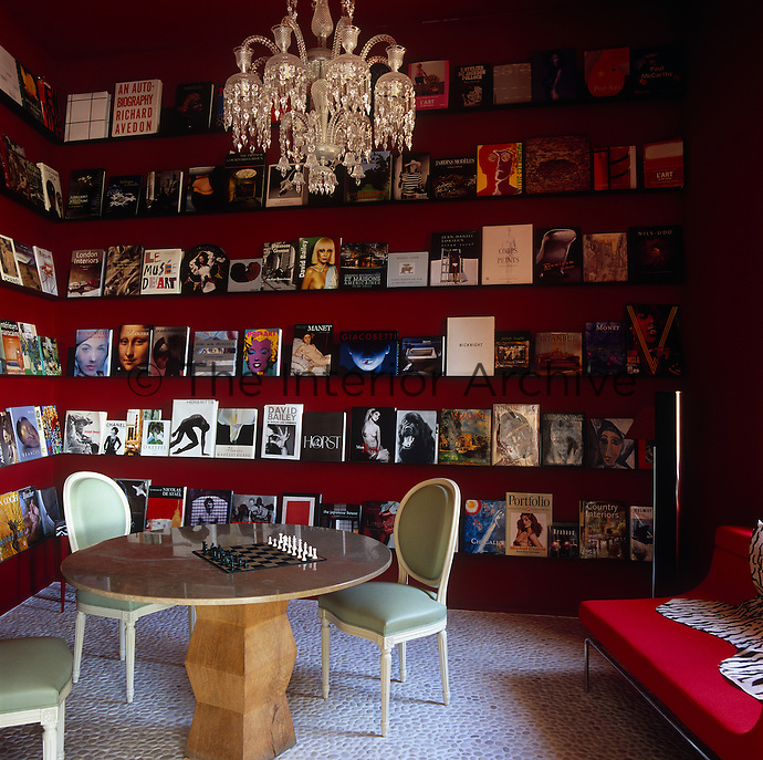 A collecton of art books are displayed around the walls of this reception room