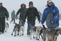 Saturday February 25, 2006 Willow, Handlers for Robert Tikium hold back dogs at the start day of the Junior Iditarod sled dog race.  Willow Lake.