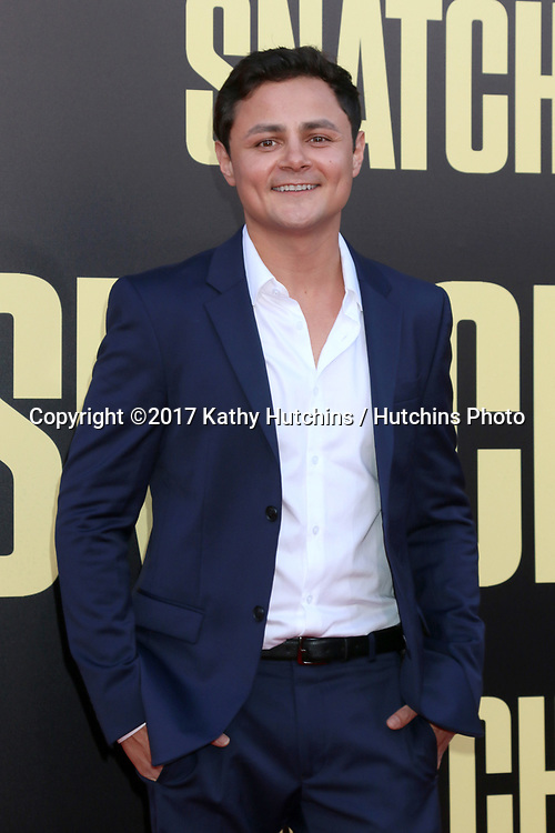 "LOS ANGELES - MAY 10:  Arturo Castro at the ""Snatched"" World Premiere at the Village Theater on May 10, 2017 in Westwood, CA"