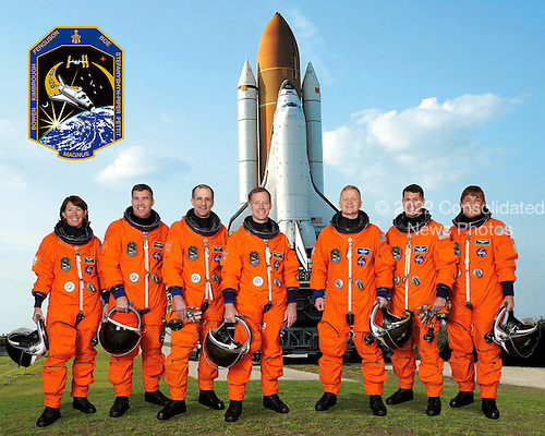 Kennedy Space Center, FL - (FILE) -- Attired in training versions of their shuttle launch and entry suits, these seven astronauts take a break from training on Wednesday, March 5, 2008 to pose for the STS-126 crew portrait. Astronaut Christopher J. Ferguson, commander, is at center; and astronaut Eric A. Boe, pilot, is third from the right. Remaining crewmembers, pictured from left to right, are astronauts Sandra H. Magnus, Stephen G. Bowen, Donald R. Pettit, Robert S. (Shane) Kimbrough and Heidemarie M. Stefanyshyn-Piper, all mission specialists. Magnus is scheduled to join Expedition 18 as flight engineer after launching to the International Space Station on mission STS-126.  The mission is scheduled for launch on Friday, November 14, 2008.  The 15-day flight will deliver equipment and supplies to the space station in preparation for expansion from a three- to six-person resident crew aboard the complex. The mission will include four spacewalks to service the station?s Solar Alpha Rotary Joints..Credit: NASA via CNP