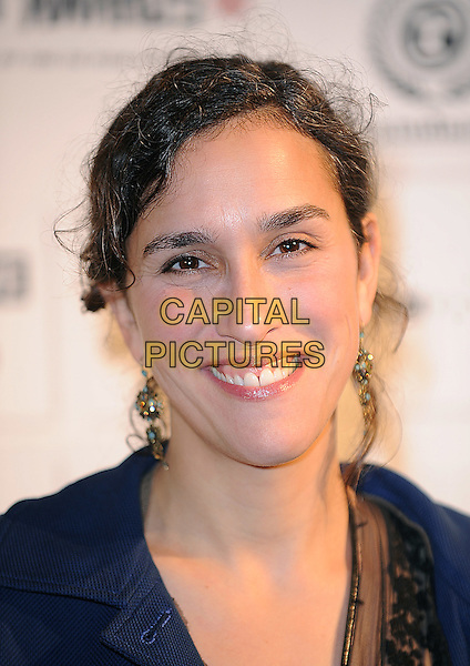 SARAH GAVON .attending the Independent Film Awards 2009, The Brewery, Chiswell Street, London, England UK, .6th December 2009. .portrait headshot  blue smiling earrings .CAP/BEL.©Tom Belcher/Capital Pictures.