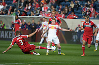 Chicago defender Hunter Jumper (3) slide tackles the ball away from New York midfilder Dax McCarty (11).  The Chicago Fire defeated the New York Red Bulls 3-1 at Toyota Park in Bridgeview, IL on April 7, 2013.