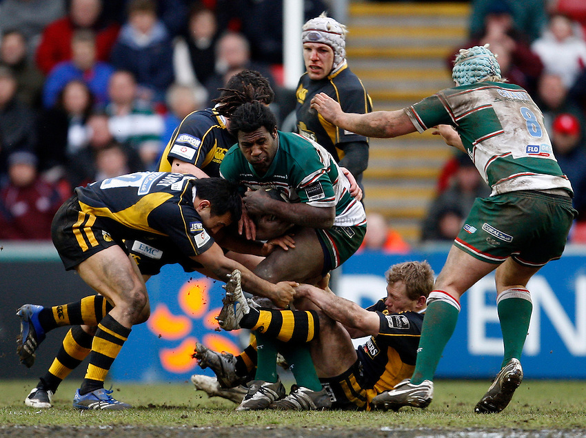 Photo: Richard Lane/Richard Lane Photography..Leicester Tigers v London Wasps. Guinness Premiership. 29/03/2008. Tigers' Seru Rabeni is held by Wasps' Riki Flutey and Josh Lewsey.