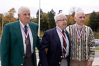 Hall of Fame members Harry Keough, Ray Kraft, and John Souza  are about to be introduced at the start of the 2004 Induction Ceremony on Monday October 11, 2004 at the National Soccer Hall of Fame and Museum, Oneonta, NY..