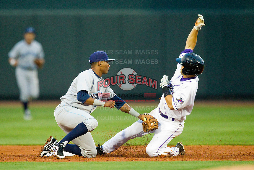 Joey DeMichele (18) of the Winston-Salem Dash steals second base ahead of the tag from Justin Trapp (7) of the Wilmington Blue Rocks at BB&T Ballpark on April 18, 2013 in Winston-Salem, North Carolina.  The Dash defeated the Blue Rocks 4-0.  (Brian Westerholt/Four Seam Images)