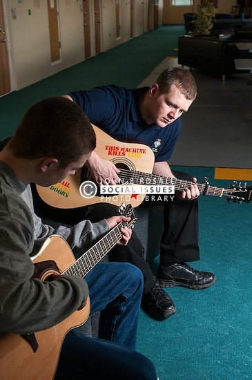 Young prisoner learning to play the guitar during association, Keppel Unit, Wetherby Young Offenders Institution