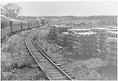 Stack of ties - truss bridge - siding - house - water tank.  Florida, Colorado - eastbound passenger train..<br /> D&amp;RGW  Florida, CO  Taken by Barriger, John W. III - 9/25/1935