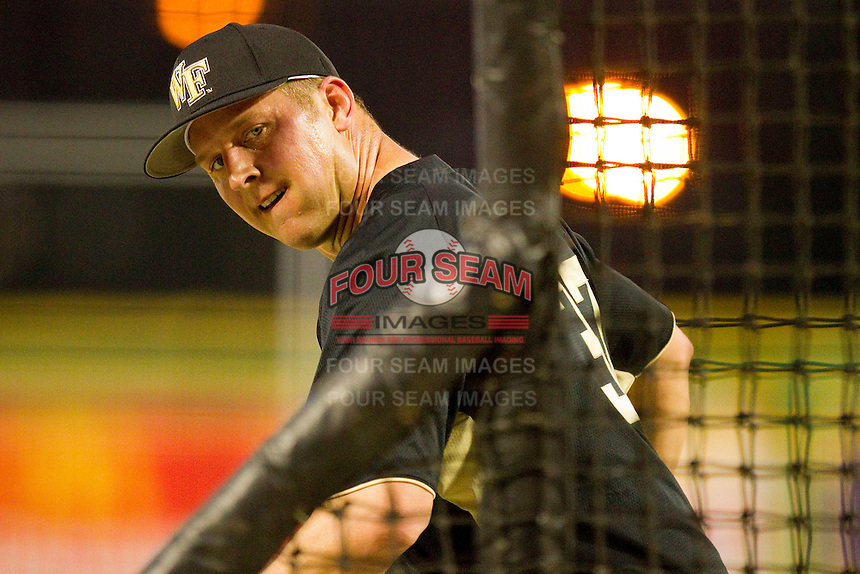 Wake Forest Demon Deacons coach Bill Cilento #37 throws batting practice prior to the game against the LSU Tigers at Alex Box Stadium on February 18, 2011 in Baton Rouge, Louisiana.  The Tigers defeated the Demon Deacons 15-4.  Photo by Brian Westerholt / Four Seam Images