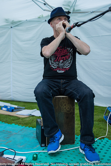 Owen McAlpine performing at the music festival; the Long Cram Jam