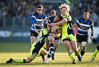 James Wilson of Bath Rugby is double-tackled by Sam James and Ross Harrison of Sale Sharks. Aviva Premiership match, between Bath Rugby and Sale Sharks on February 24, 2018 at the Recreation Ground in Bath, England. Photo by: Patrick Khachfe / Onside Images