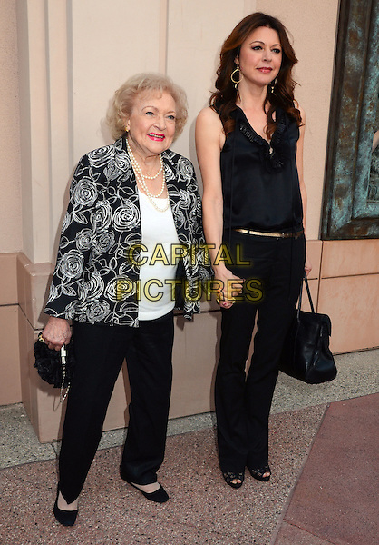 Betty White, Jane Leeves.TV Land presents An Evening with Iconic TV Actresses held at Leonard H. Goldenson Theatre, North Hollywood, California, USA..May 10th, 2012.full length black white print blazer top trousers holding hands.CAP/ADM/BT.©Birdie Thompson/AdMedia/Capital Pictures.