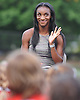 Crystal Dunn, a Rockville Centre native and member of the 2016 US women's Olympic soccer team, waves to spectators during a ceremony honoring her at Hempstead State Park on Wednesday, July 13, 2016.